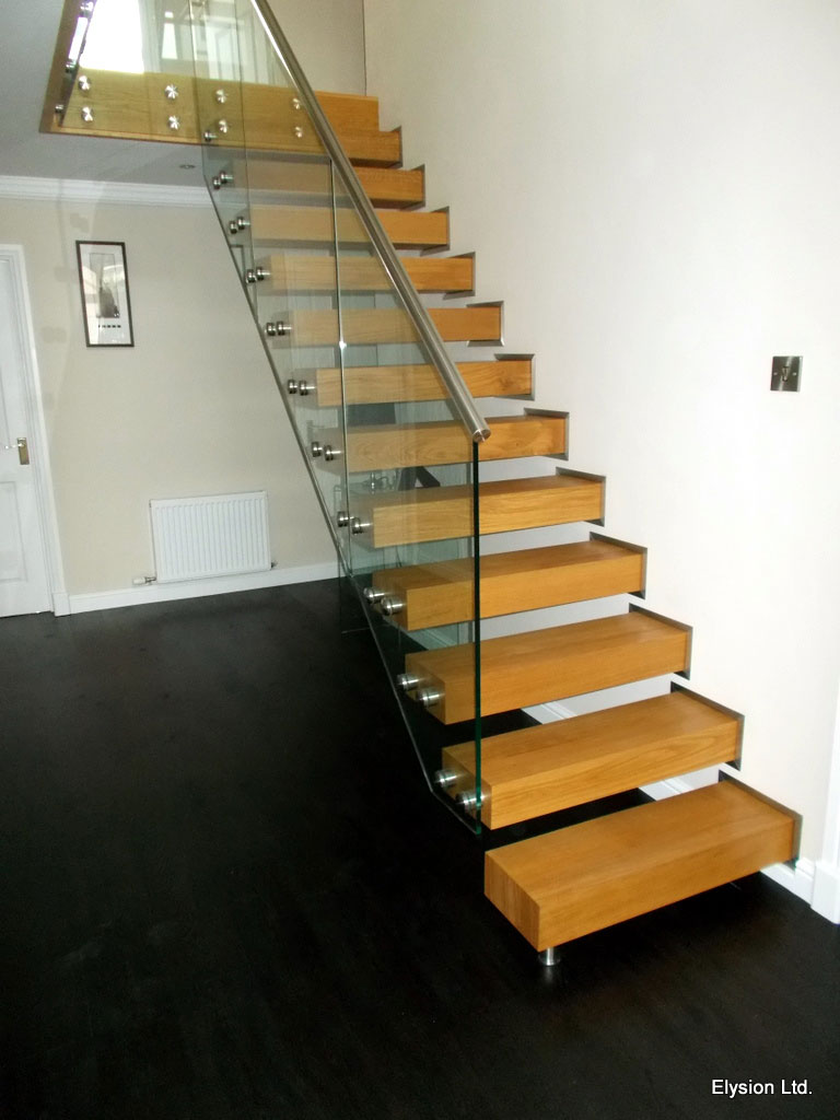Glass balustrading on one side of a staircase